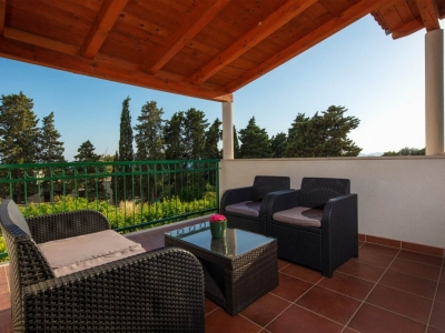 Covered first floor terrace with garden furniture for relaxing