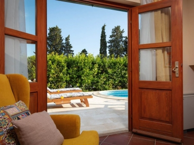 Open French doors and access to the pool