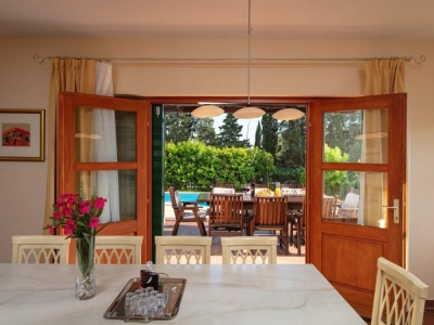 View from the dining room to the terrace and private outdoor pool