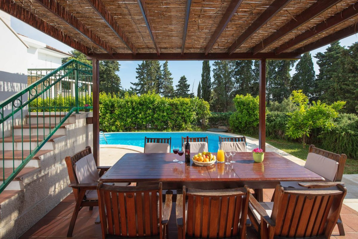 Covered dining table by the pool