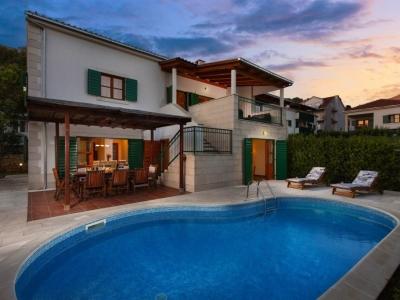 Villa Liza with pool at dusk